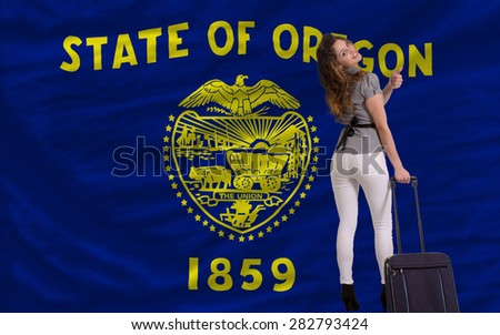 young beautiful woman is traveling to oregon - stock photo