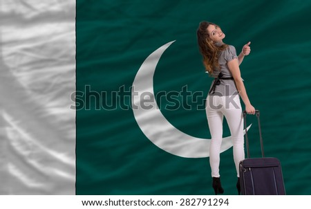 young beautiful woman is traveling to pakistan - stock photo