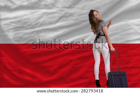 young beautiful woman is traveling to poland - stock photo