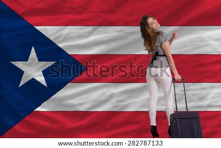 young beautiful woman is traveling to puertorico