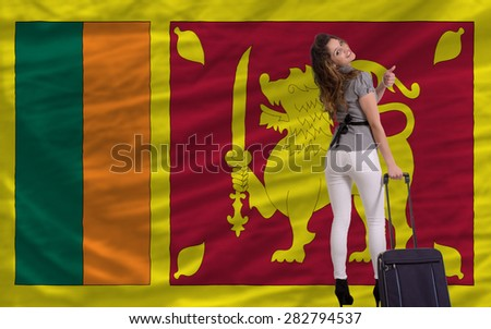 young beautiful woman is traveling to sri lanka