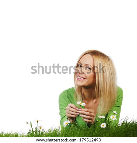 Young beautiful woman laying on daisy flowers field isolated on white background