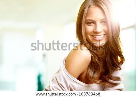 Young beautiful woman looking at camera - stock photo