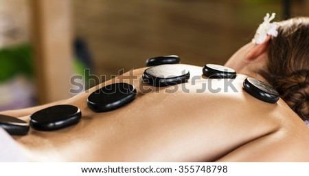 Young beautiful woman lying on massage table and waiting therapist - stock photo