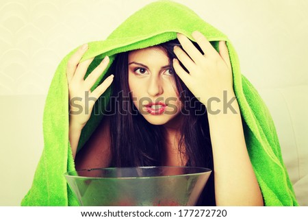 Young beautiful woman making inhalation at home.  Natural medicine concept