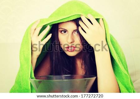 Young beautiful woman making inhalation at home.  Natural medicine concept - stock photo