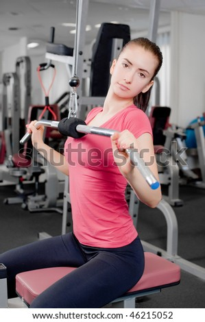 young beautiful woman making physical exercises in a fitness center