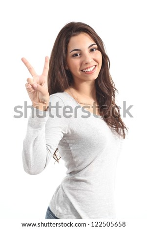 Young beautiful woman making victory sign on a white isolated background - stock photo
