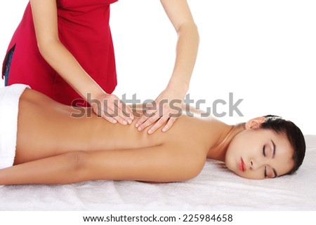 Young beautiful woman massage in spa - stock photo