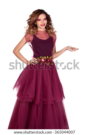 Young beautiful woman model in fairy red marsala dress showing empty copy space for product on the open hand palm, Isolated on white background.