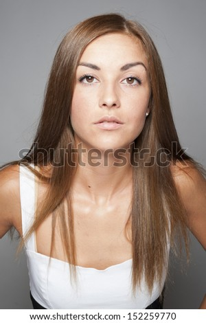 Young beautiful woman natural posing on white background