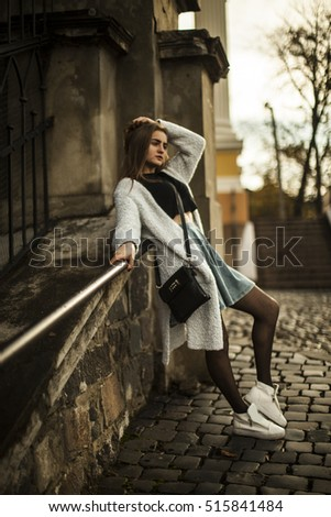 Young beautiful woman on a background of the city.