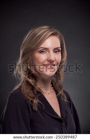 Young beautiful woman on a black background
