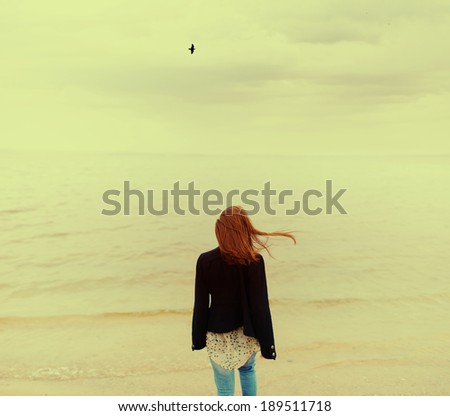 Young beautiful woman on an ocean coast