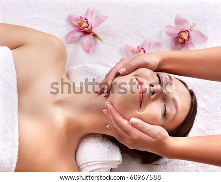 Young beautiful woman on massage table in beauty spa. Series. - stock photo