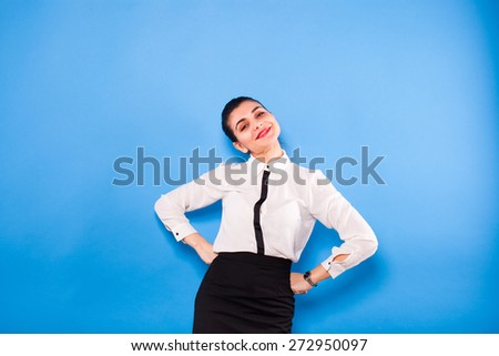 young beautiful woman on office outfit holding something above her head, on blue background