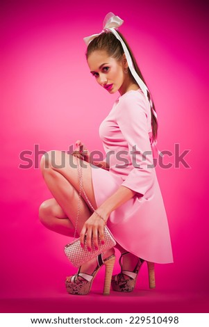 young beautiful woman on pink background - stock photo