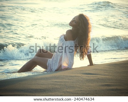 young beautiful woman on the beach - stock photo