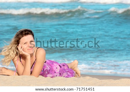 young beautiful woman on the shore of the sea