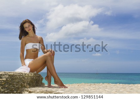 young beautiful woman on tropical sea background - stock photo