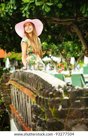 Young beautiful woman outdoors on the bridge