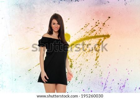 young beautiful woman over graffiti background - stock photo