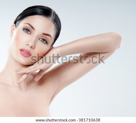 Young beautiful woman. perfect skin. armpit's care - stock photo