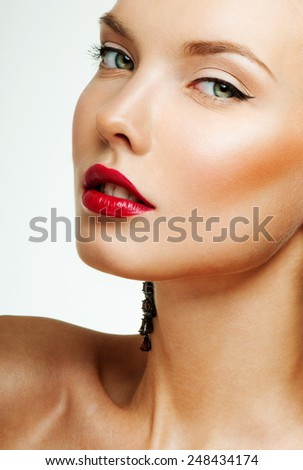 young beautiful woman. perfect skin. red lipstick. - stock photo