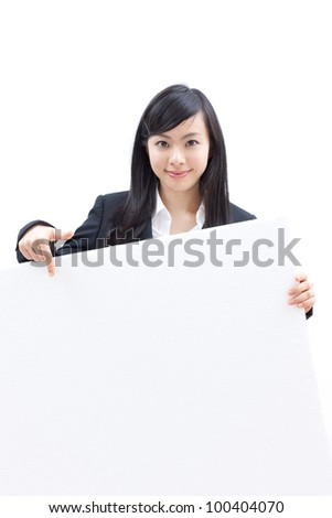 young beautiful woman pointing blank billboard, isolated on white background