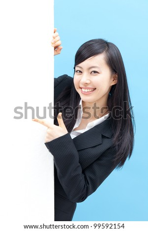 young beautiful woman pointing blank billboard, isolated on white background - stock photo