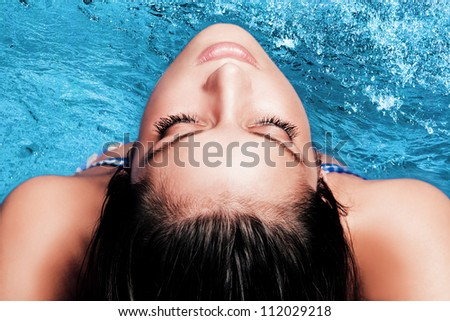 young beautiful woman portrai  above water - stock photo