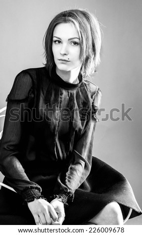 young beautiful woman portrait black and white in studio