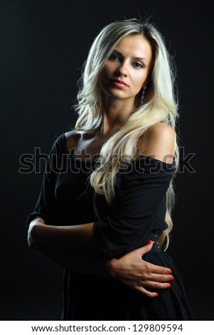 Young beautiful woman portrait on dark background - stock photo