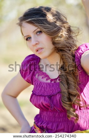 young beautiful woman portrait on field in summer