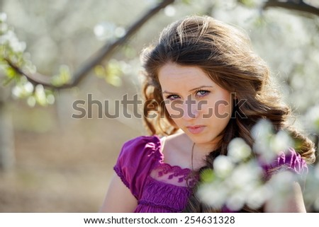 young beautiful woman portrait on field in summer - stock photo