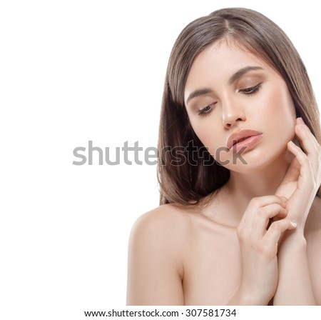 Young beautiful woman portrait with healthy skin studio