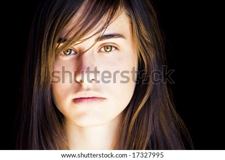 Young beautiful woman portrait with impressive green eyes. - stock photo