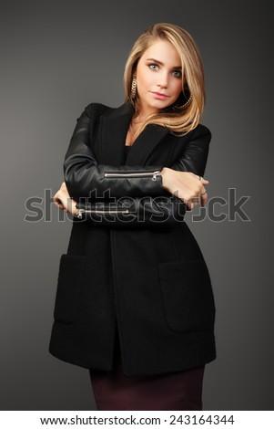 Young beautiful woman portrait with long hair in studio shot. Teen girl beautiful cheerful enjoying. Glamorous young woman in black leather jacket.  - stock photo