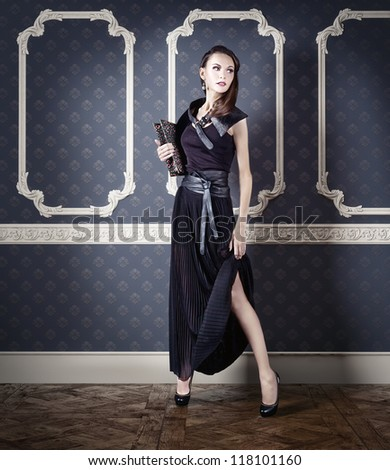 young beautiful woman posing in an vintage room - stock photo