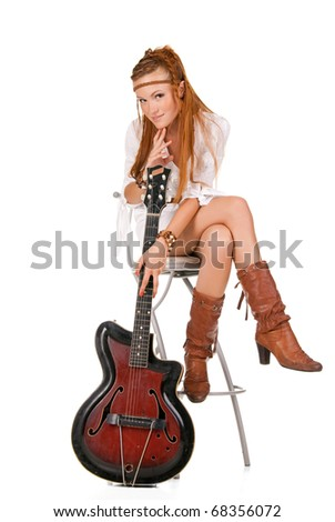 young beautiful woman posing in studio with guitar
