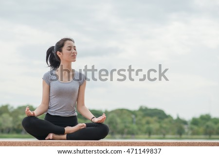 Young Beautiful Woman Practices Yoga . Active Lifestyle