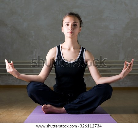 Young beautiful woman practicing yoga - stock photo