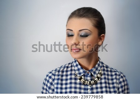 Young beautiful woman, professional make up, hair styling. Student or business lady, shirt, blouse Woman is ready for the party or the great event. Free space on photo area place for text, inscription - stock photo