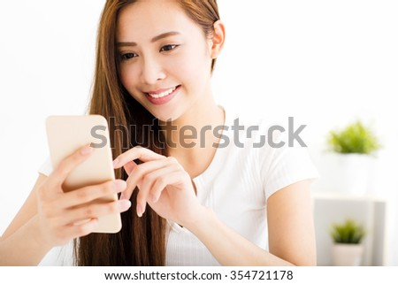 young beautiful woman reading message with smart phone - stock photo