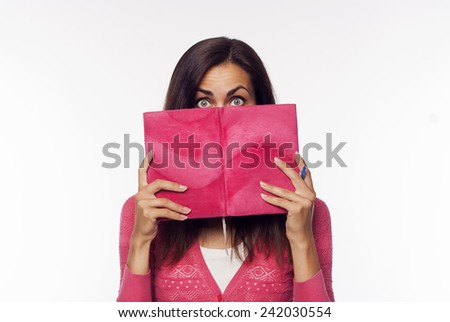 Young beautiful woman reading over white background - stock photo