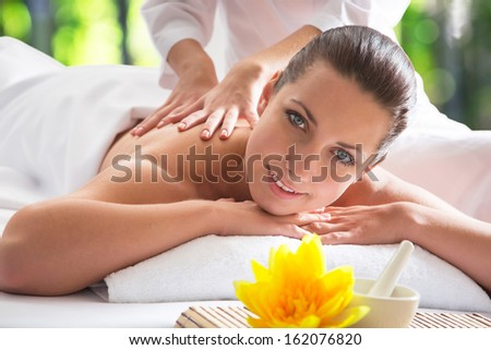 Young beautiful woman relaxed in spa environment - stock photo