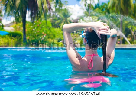 young beautiful woman relaxing in spa pool - stock photo