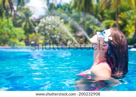 young beautiful woman relaxing in spa pool - stock photo