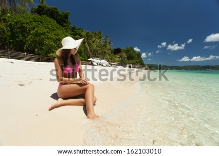Young beautiful woman relaxing on the beach