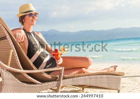 young beautiful woman relaxing on tropical beach, summer vacations - stock photo